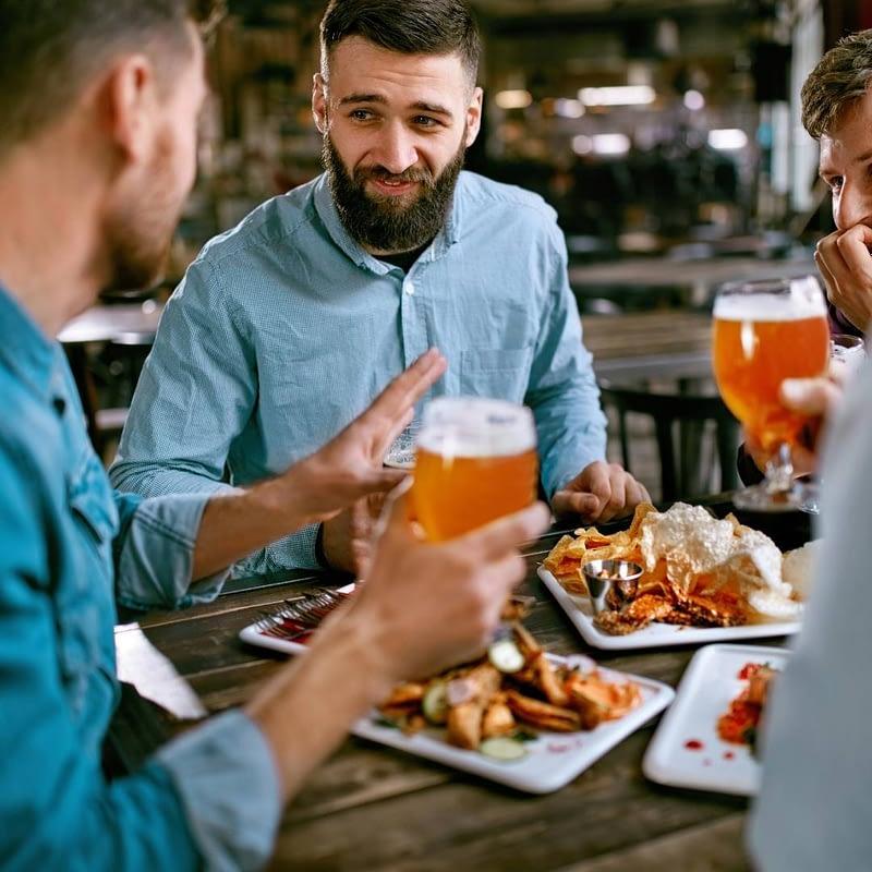 men having dinner with craft beer